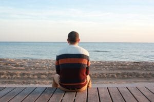 Man sitting alone watching the sea