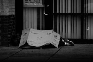 Someone sleeping rough with cardboard